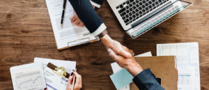 Shaking hands when buying a website